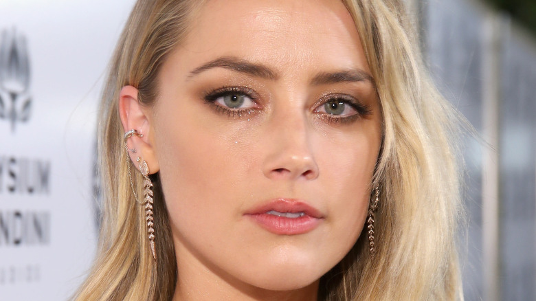 Amber Heard flaunts cleavage in costume as Mera in Aquaman