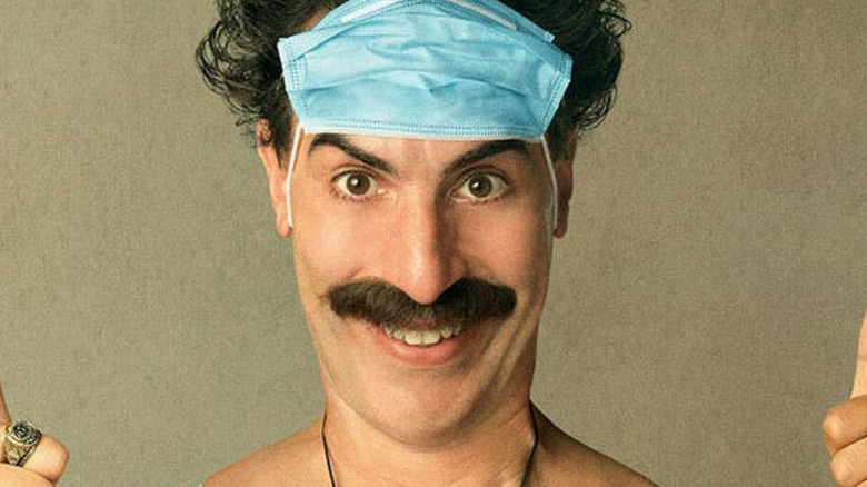 Borat 2 mask on face thumbs up