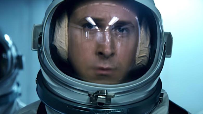 Neil Armstrong wearing an astronaut helmet
