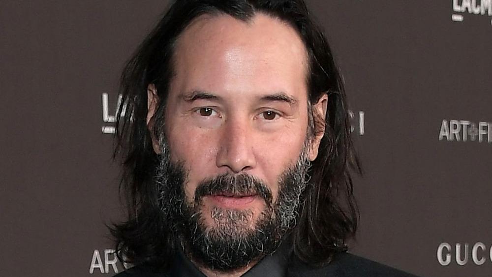 Keanu Reeves beard grinning