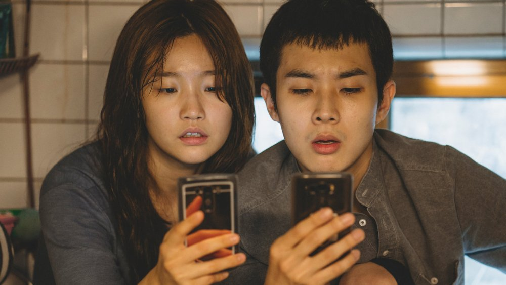 Choi Woo-shik as Kim Ki-woo and Park So-dam as Kim Ki-jeong in Parasite