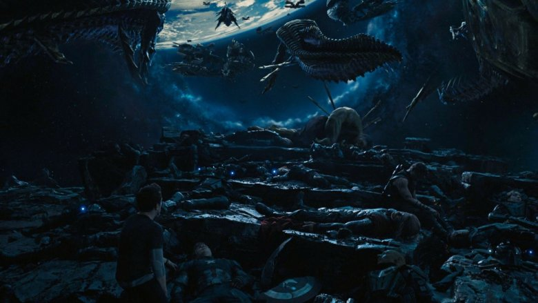 Robert Downey Jr. as Tony Stark looking over the fallen Avengers in Avengers: Age of Ultron