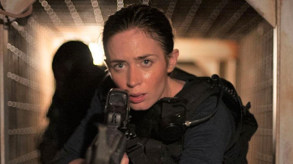 Emily Blunt with gun