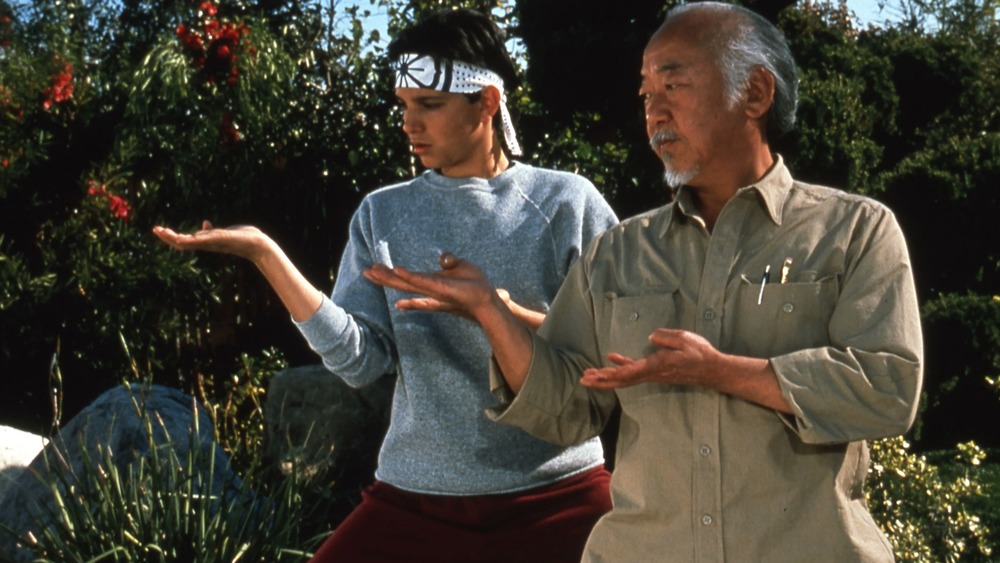 Ralph Macchio and Pat Morita working out in The Karate Kid