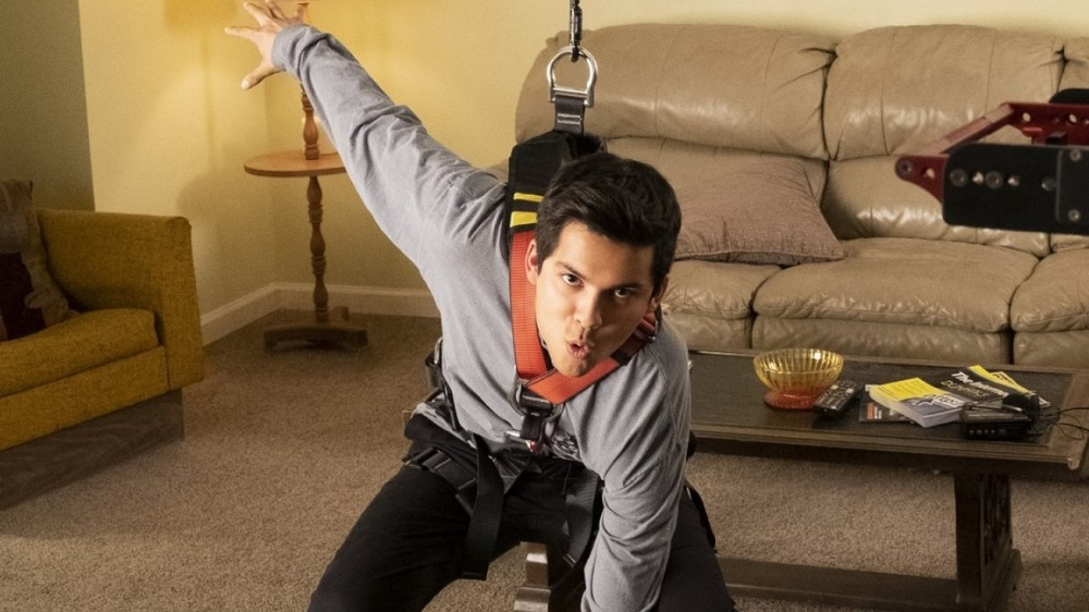 Xolo Mariduena does martial arts in a living room