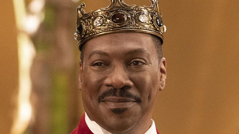Prince Akeem wears a crown