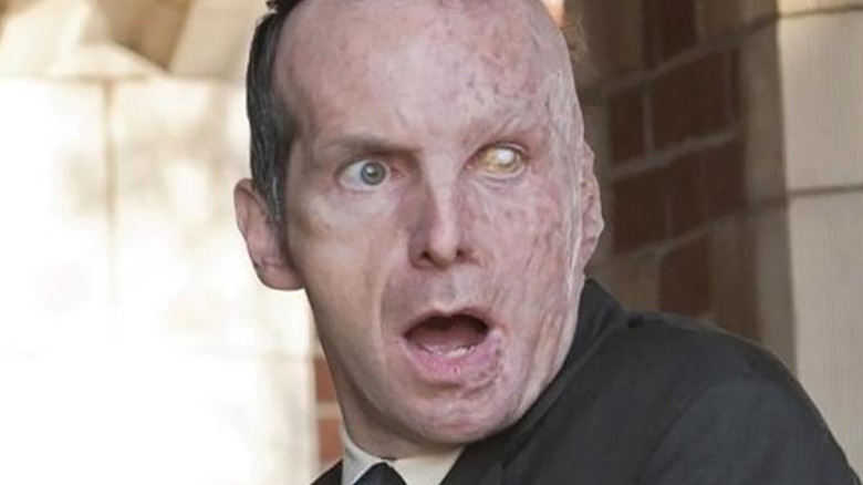 Denis O'Hare as Larry Harvey in American Horror Story: Murder House