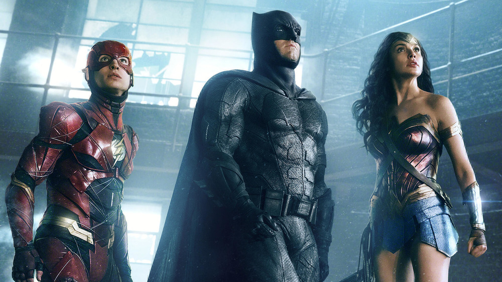 The Flash, Batman, Wonder Woman look up