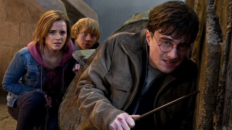 Emma Watson as Hermione Granger, Rupert Grint as Ron Weasley, and Daniel Radcliffe as Harry Potter