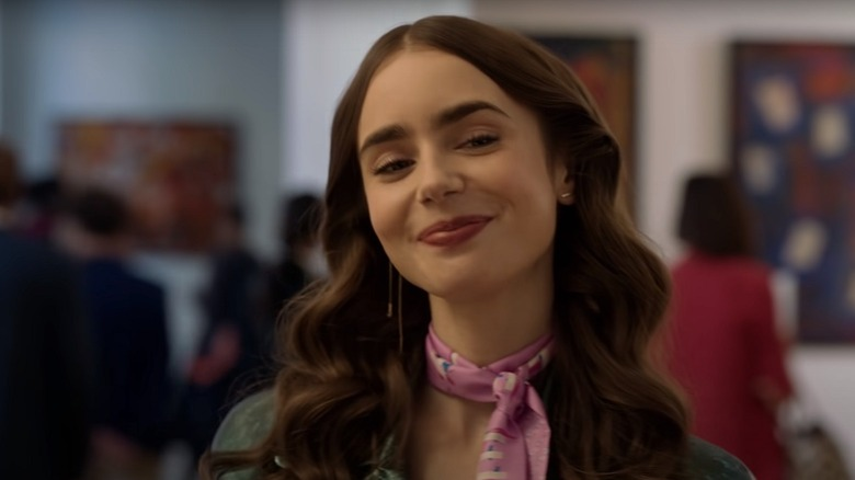 Emily (Lily Collins) smiles during a scene included in Netflix's Emily in Paris trailer.