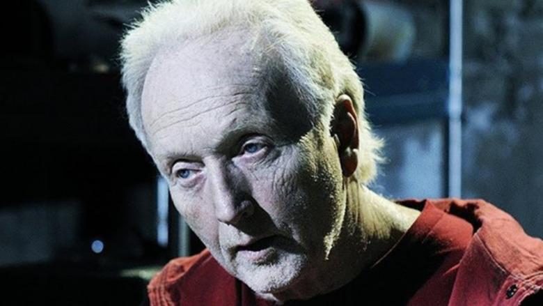 John Kramer wearing red jacket