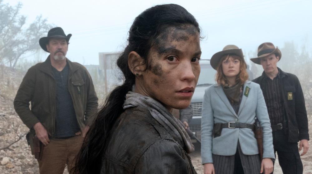 Luciana looks over her shoulder
