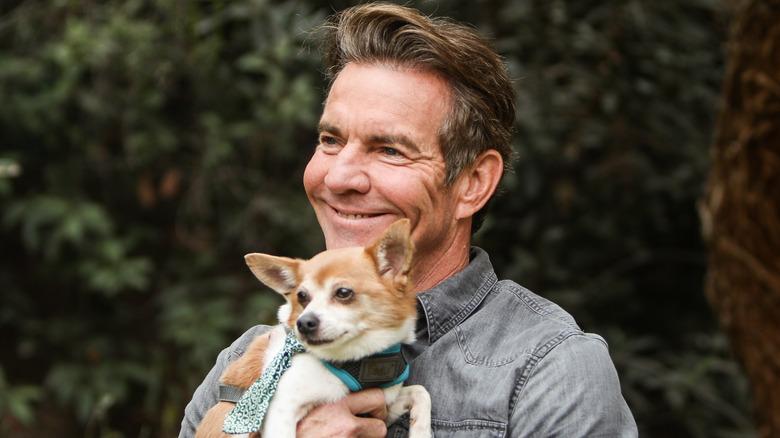 Dennis Quaid holding small dog