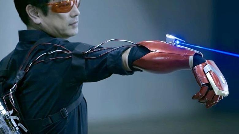 Grant Imahara using his Iron Man gauntlet