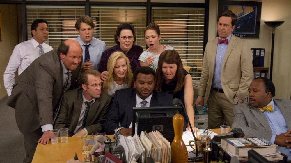 The Office cast gathers around a computer