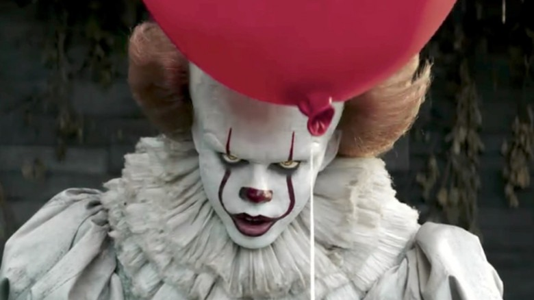Pennywise holds a red balloon in It