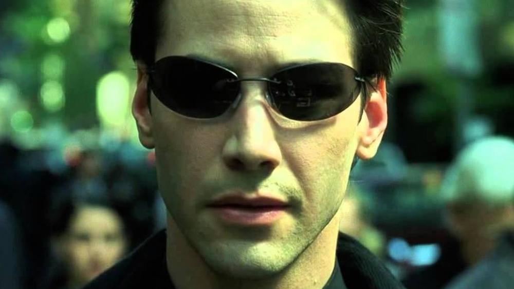 Neo in a crowd in the Matrix