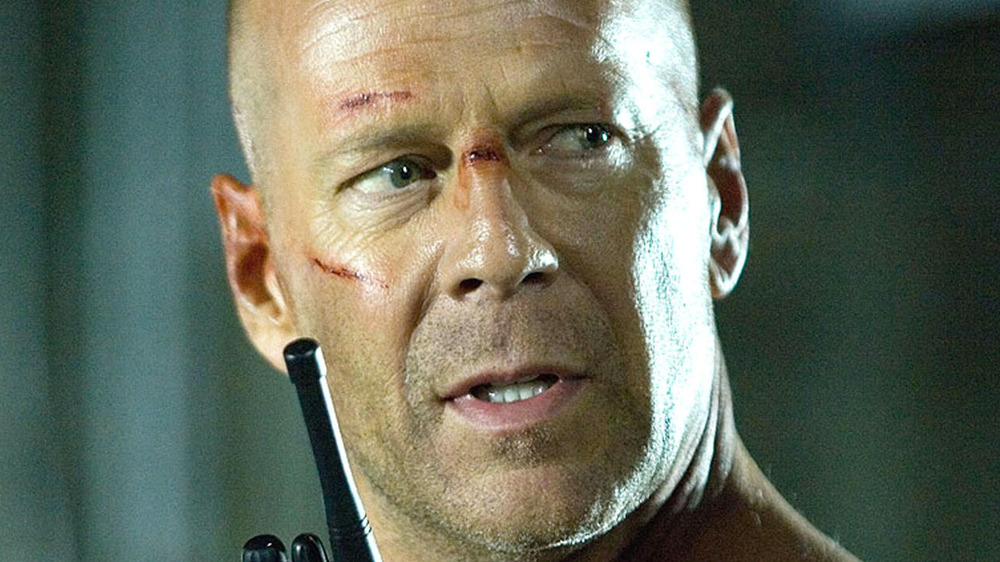 John McClane talking on a walkie-talkie