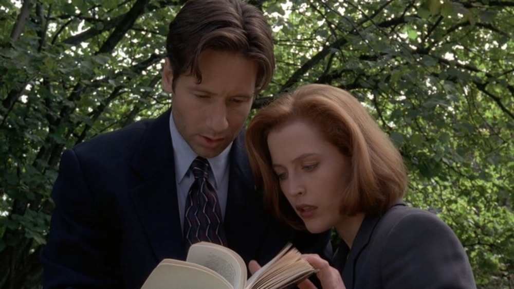 Mulder and Scully examine a book