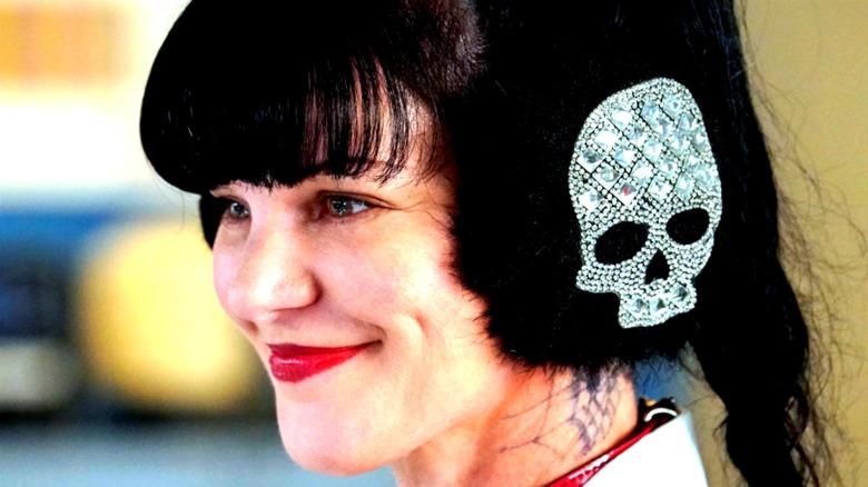 Abby wearing skull-shaped ear protectors