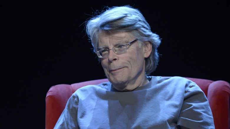 Stephen King smiles