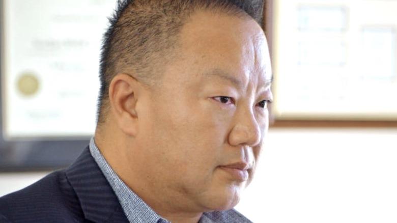 Dr. Gabriel Chiu wearing suit