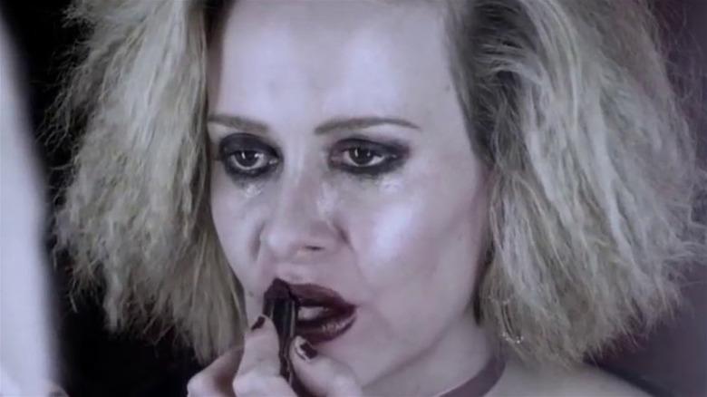 Hypodermic Sally puts on lipstick