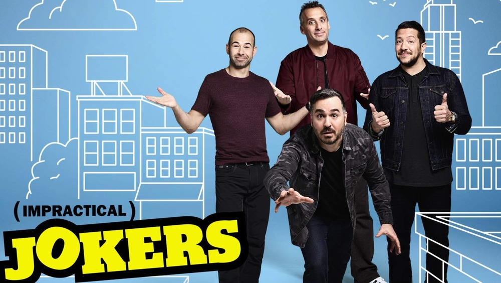The Impractical Jokers cast pose in front of cartoon New York skyline