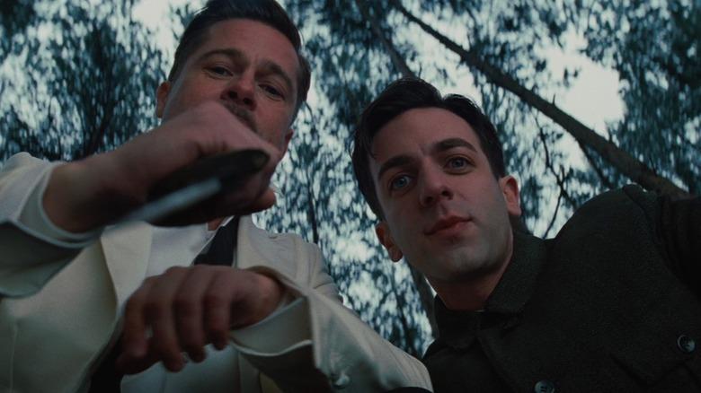 Brad Pitt and BJ Novak hold a knife in Inglourious Basterds