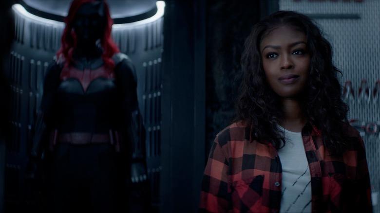Ryan Wilder stands near her Batwoman costume