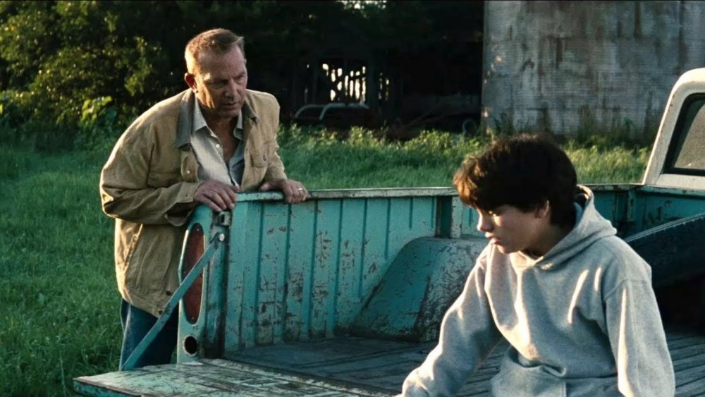 Kevin Costner as Johnathan Kent and Dylan Sprayberry as 13-year-old Clark Kent in Man of Steel