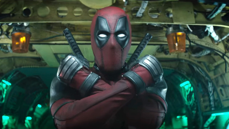 Deadpool, arms crossed, ready for a jump