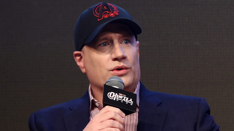 Kevin Feige holding microphone