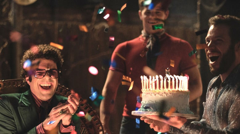 Zachary Quinto with a cake