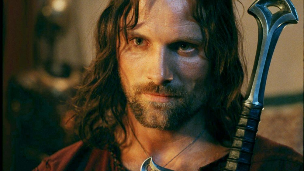 Viggo Mortensen as Aragorn carrying Andúril in The Lord of the Rings