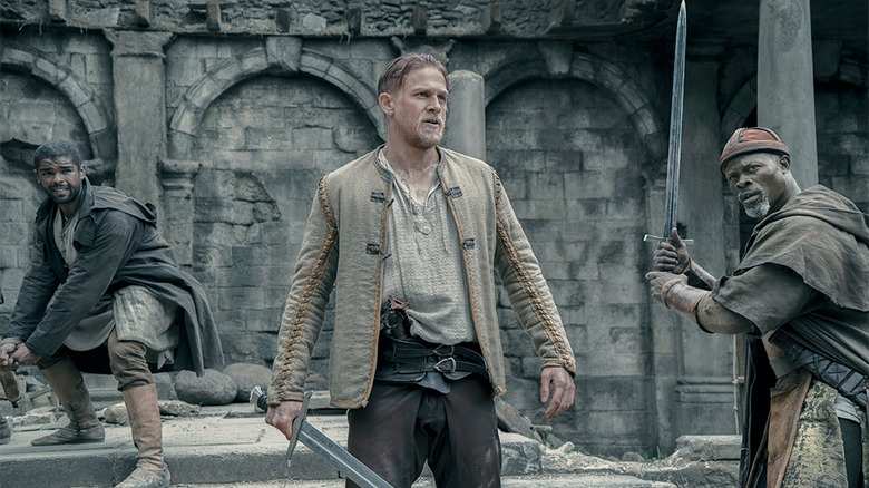 Kingsley Ben-Adir, Charlie Hunnam, and Djimon Hounsou in King Arthur: Legend of the Sword