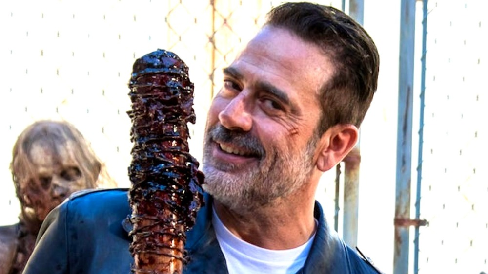 Walking Dead's Negan holding bloody Lucille bat