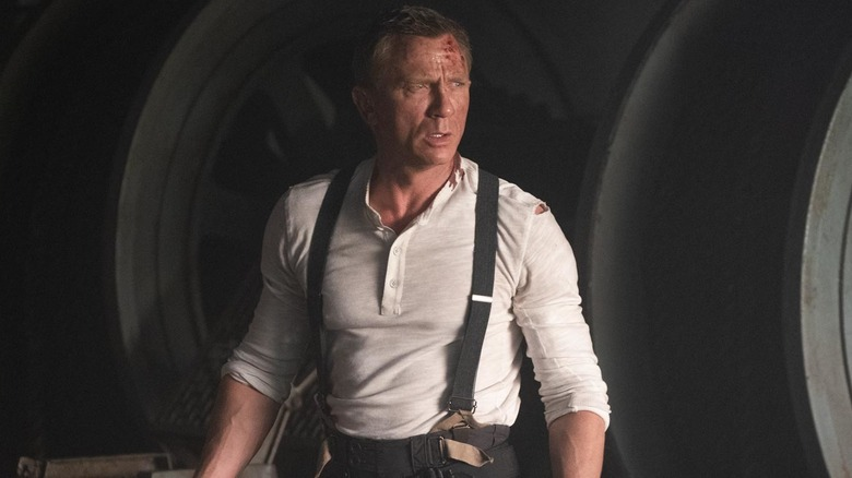 Daniel Craig as Bond in suspenders