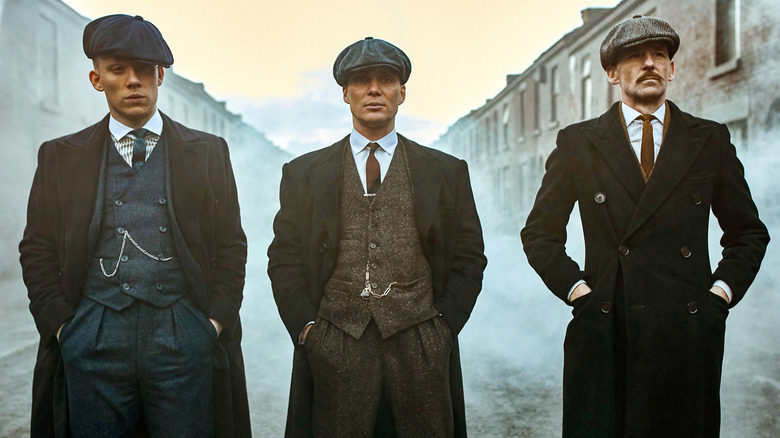 Tommy, Arthur, and John Shelby stand intimidatingly