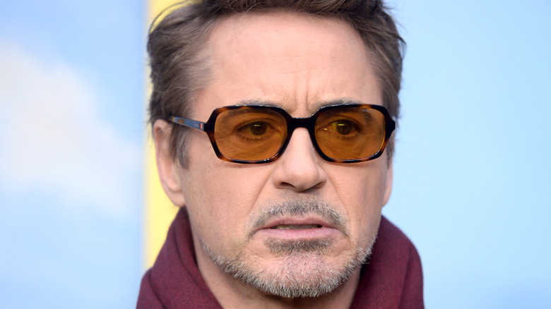 Robert Downey Jr. posing for camera with his signature glasses