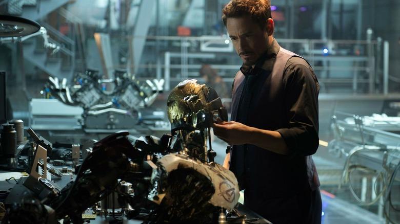 Tony examines robot