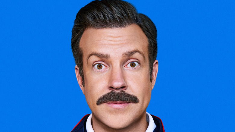 Ted Lasso smiling wide-eyed