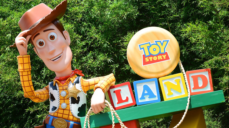 A Woody figure welcome's guests to Disney World's Toy Story Land