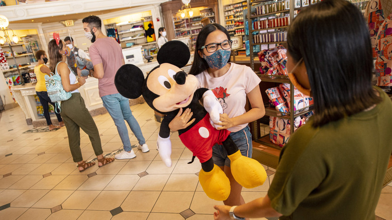 A child chooses a toy in one of Disney World's many gift shops