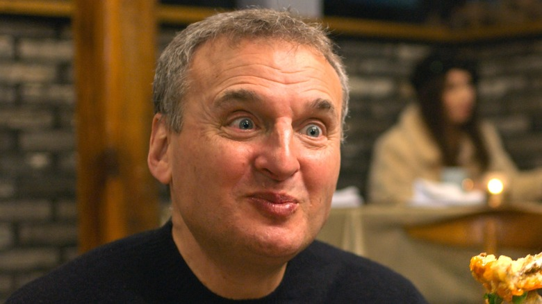Phil Rosenthal eating happy