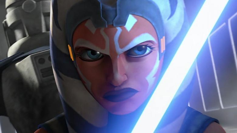 Ahsoka Tano wields her lightsaber in Star Wars: The Clone Wars