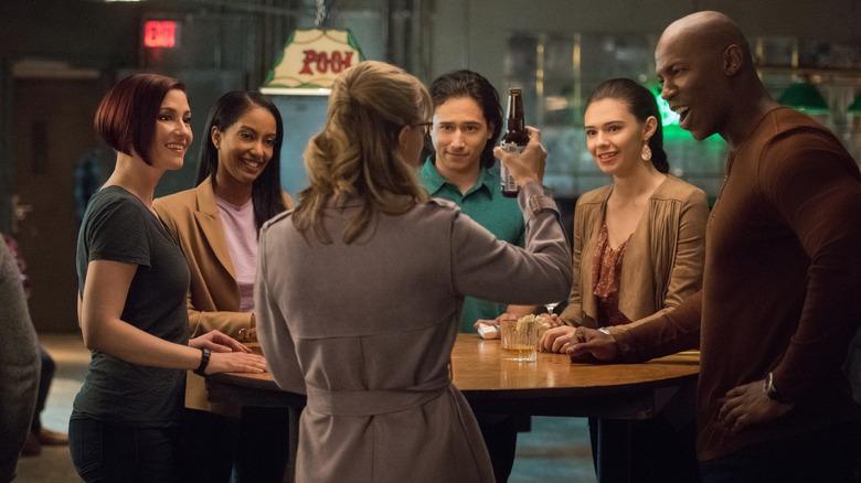 Kara Danvers (Melissa Benoist) toasting Team Supergirl