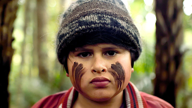 Julian Dennison as Ricky determined with face paint
