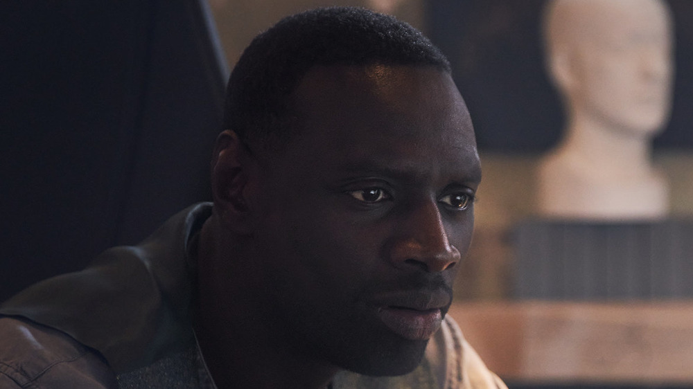 Omar Sy staring intently