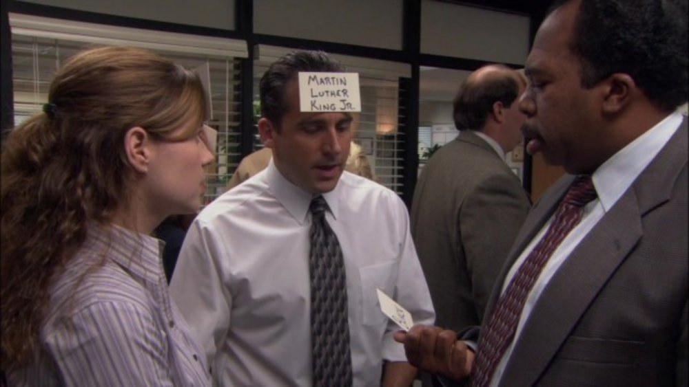 Pam (Jenna Fischer) and Stanley (Leslie David Baker) get advice from Michael (Steve Carell) on The Office